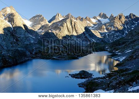 Beautiful Alpine Lake Reflecting an Alpine Skyline.  Titcomb Basin, The Wind River Range, Wyoming