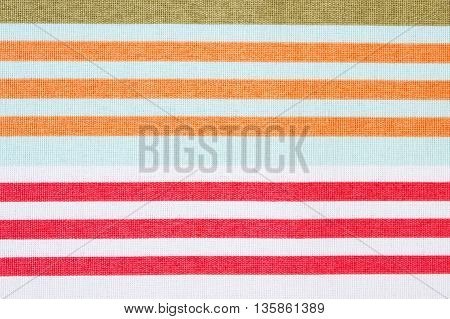 Colorful fabric as background striped tablecloth texture as backdrop