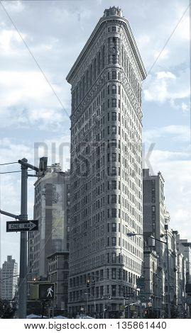 NEW YORK CITY USA - June 24 2016 - The iconic Flatiron Building in Manhattan with a blue monotone effect