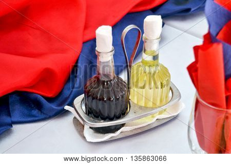 picture of an oil and vinegar bottles on a restaurant table