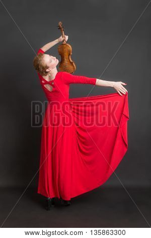 woman with a violin in a red dress
