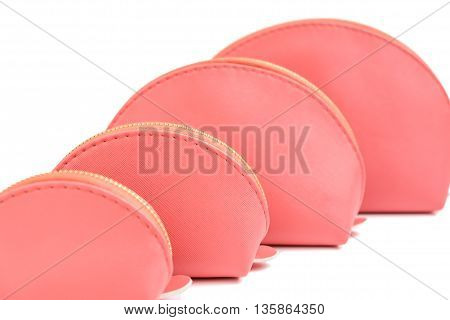Selective focus on the second pink cosmetic round bags set - pink bags collection in four size isolated object on white background