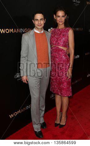 NEW YORK-MAR 30: Katie Holmes (R) and designer Zac Posen attend the