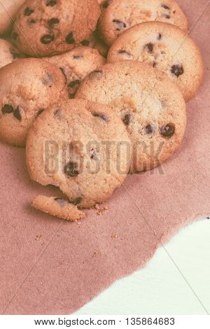 Tasty homemade american chocolate chip cookies on rustic wooden table