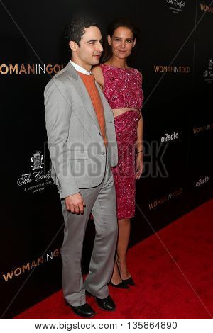 NEW YORK-MAR 30: Actress Katie Holmes (R) and designer Zac Posen attend the