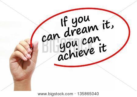 Man writing If you can dream ityou can achieve it with marker on transparent wipe board.