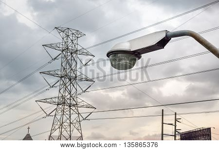 Street light pole with high voltage tower and cable line in morning sky, Bangkok, Thailand (light, sky, morning)