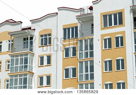 Modern new executive apartment building on a white background