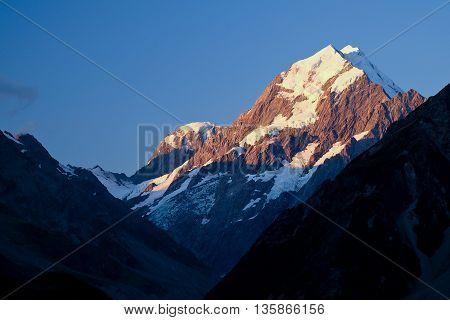 Sunset Illuminates The High and Snowy Peak of Mt Cook. Mt Cook National Park New Zealand