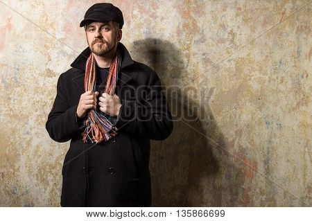 Serious Bearded Man Wearing A Cap And Autumn Coat