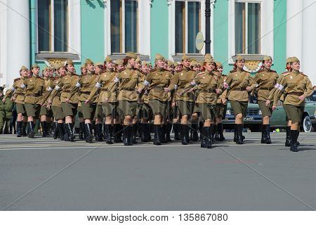 SAINT PETERSBURG, RUSSIA - MAY 05, 2015: Girls military doctors during world war II on the rehearsal of parade in honor of Victory Day