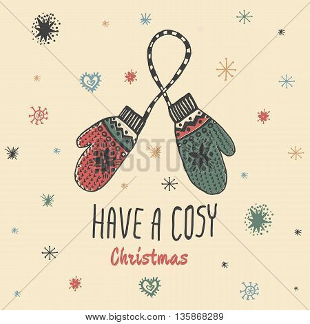 Christmas vintage card with with hand drawn mittens and text 'Have a Cosy Christmas'. Vector hand drawn illustration on beige background.