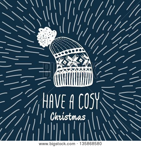 Christmas vintage card with with hand drawn knitted winter hat and text 'Have a Cosy Christmas'. Vector hand drawn illustration on blue background.