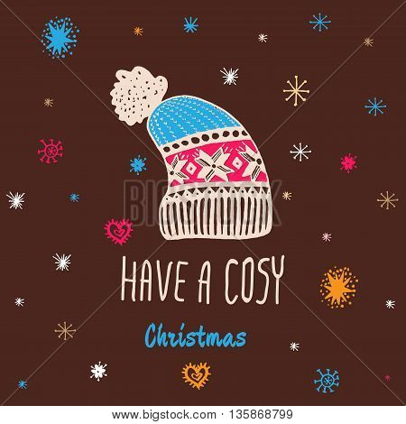 Christmas vintage card with with hand drawn knitted winter hat and text 'Have a Cosy Christmas'. Vector hand drawn illustration on brown background.