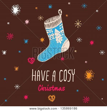 Christmas vintage card with with hand drawn knitted sock and text 'Have a Cosy Christmas'. Vector hand drawn illustration on blue background.