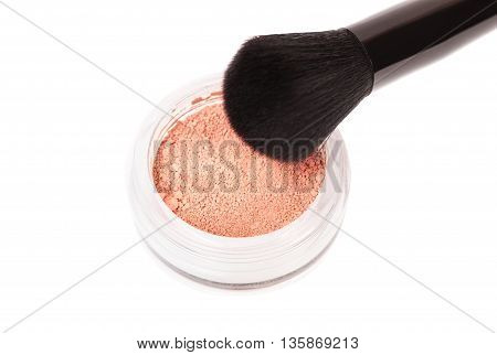 Powder blush and black makeup brush on white background