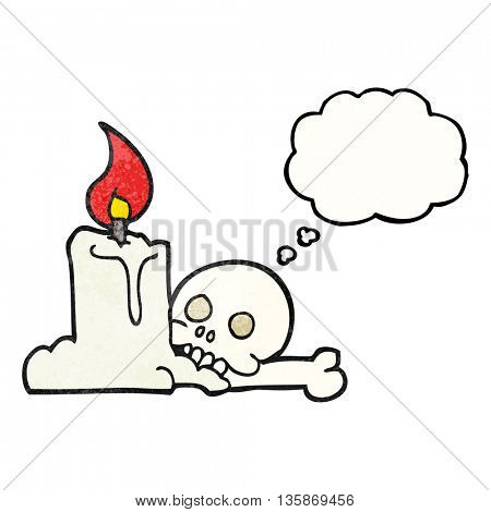 freehand drawn thought bubble textured cartoon spooky skull and candle