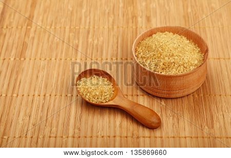 Scoop And Bowl Of Brown Cane Sugar On Mat
