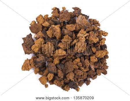 Close up Crushed Chaga Mushroom on white