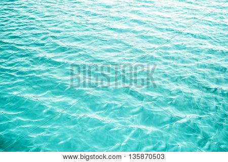 close up blue ripple water texture background.