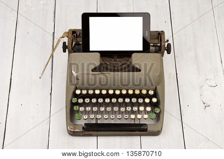 Concept Of Technology Progress - Old Typewriter And New Tablet Pc
