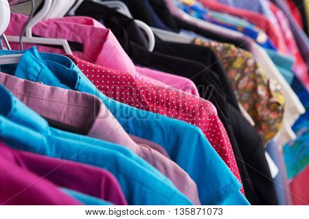 Fashion set - colorful clothes hanging on the rack