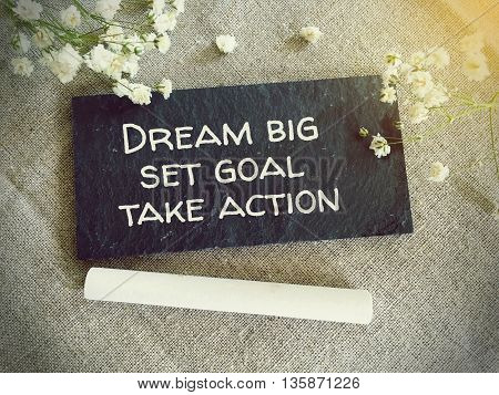 Blackboard for your text and flowers with words dream big set goal take action