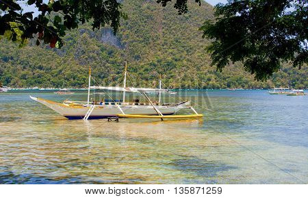 Traditional Philippine boat on the beach, El Nido. Palawan island. Philippines.