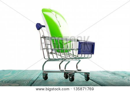 Wireless Computer Mouse In A Miniature-shopping Cart Isolated On White