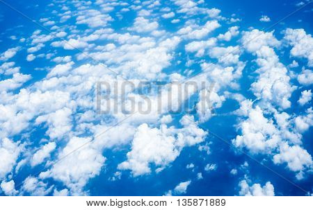 Aerial view of Blue sky and Cloud Top view from airplane windowNature background.