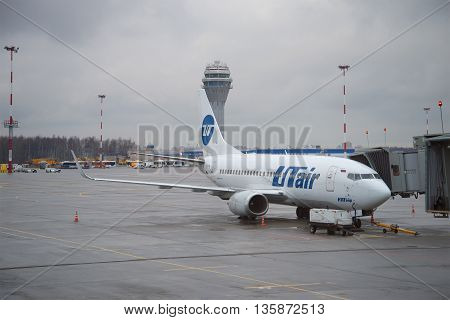 SAINT PETERSBURG, RUSSIA - DECEMBER 12, 2015: A Boeing 737-500 (VQ-BJQ) airlines UTair stands at the gangway of the airport Pulkovo