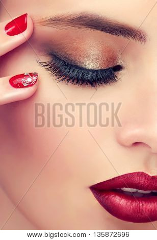 Luxury fashion style, manicure nail , cosmetics and makeup . Red lips  and  long eyelashes