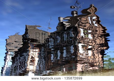reflection of old timbered house on water in Colmar, in Alsace province of France