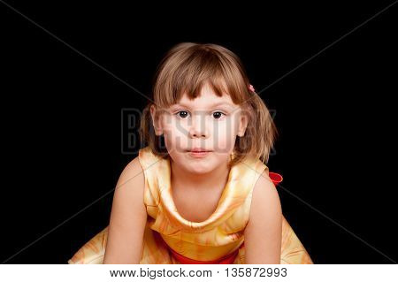 Studio Portrait Of Smiling Little Caucasian Blond Girl