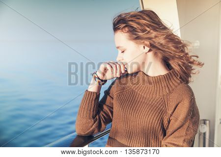 Beautiful Blond Teenage Girl Stands On Cruise Ship