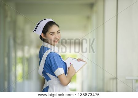 Beautiful young nurse on duty at hospital