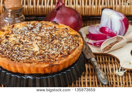 Homemade tart of red onion with sesame and flax seed. A rustic style. Selective focus