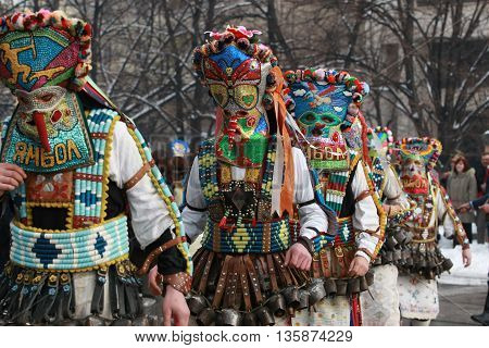 Pernik, Bulgaria - January30, 2010: Unidentified man in traditional Kukeri costume are seen at the Festival of the Masquerade Games Surva in Pernik, Bulgaria.