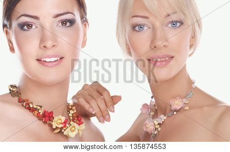 Portrait of a two beautiful women with necklace, isolated on white background