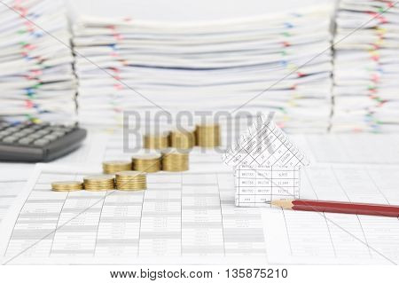 House And Pencil Have Blur Step Gold Coins As Background