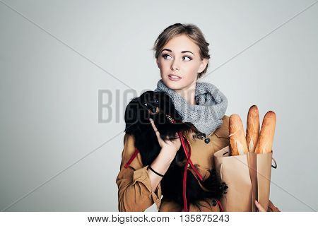 French Woman with Small Dog and Baguette on Background with Copy Cpace