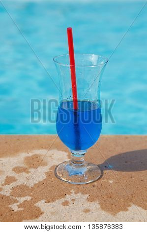 blue cold fresh cocktail near the pool