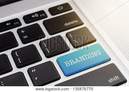BRANDING : Close up  Green button keyboard computer