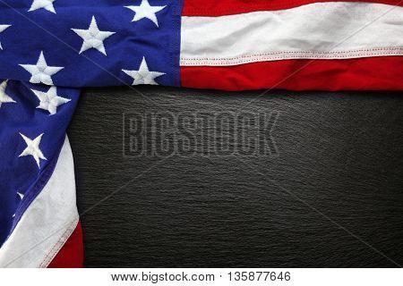 USA flag on black slate background