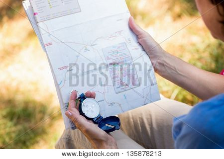 focus on a map in a forest