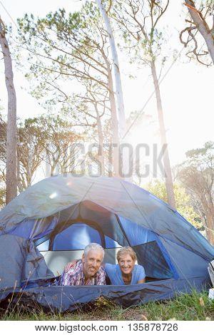 senior couple elongating inside their tent