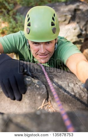 Close up man rock climbing on the nature