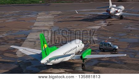 Kiev Ukraine - May 17 2012: South Airlines Saab 340B parked on the apron of the airport with another plane and a