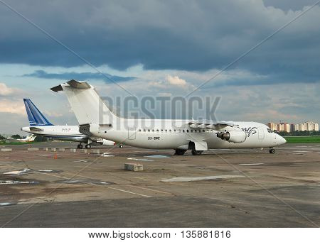 Kiev Ukraine - May 17 2012: Passenger planes at the airport with dramatic stormy sky on the background