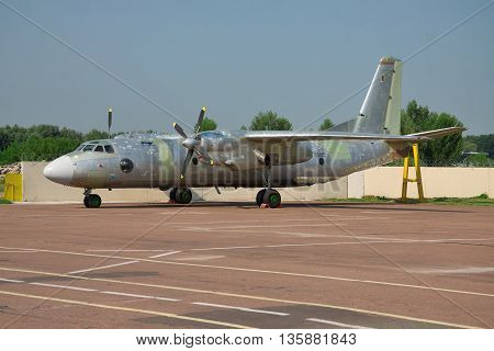 Kiev Ukraine - July 7 2012: Antonov An-26 cargo plane with its paint being washed away during the maintenance check